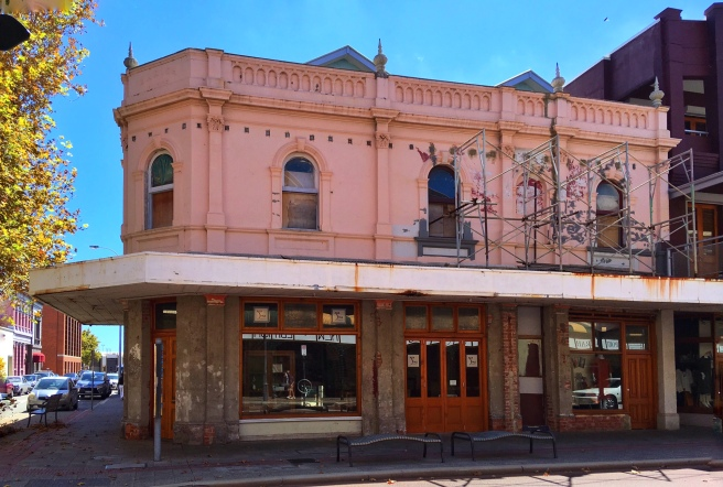 NOT PARIS. A neglected building in the heart of Fremantle's West End. Rumour is that this may become a victim of demolition and increased height. A chance for councillors to consider their obligations to voters, not to developers. ©Roger Garwood 2016